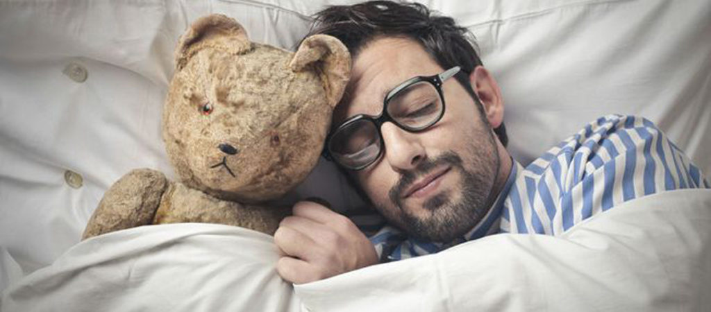 man-sleeping-with-teddy-bear