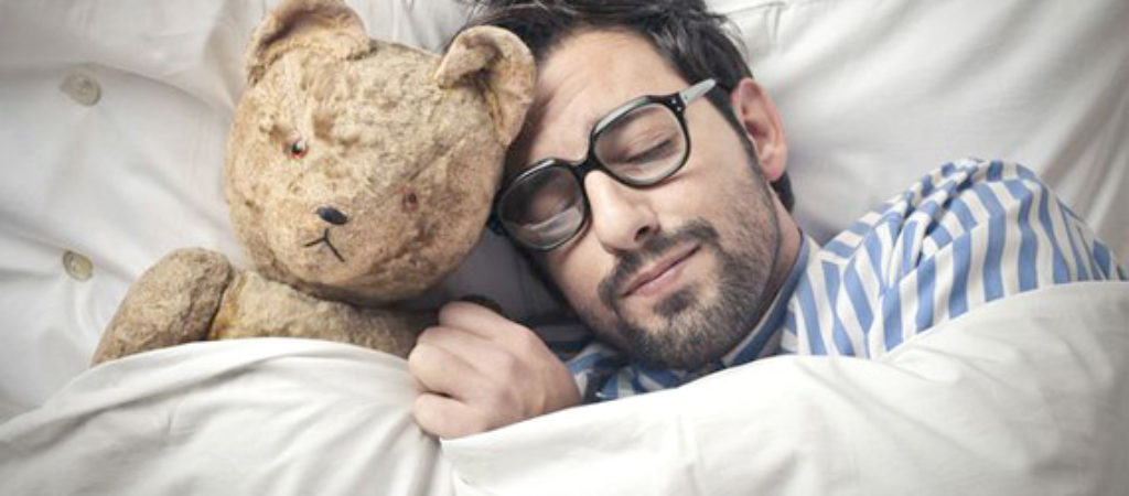 man-sleeping-with-teddy-bear-570